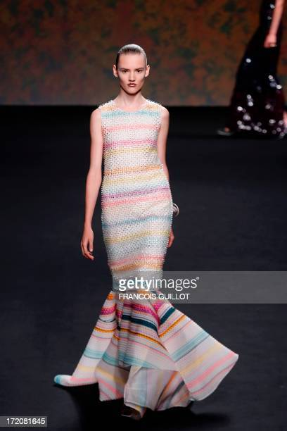 A model presents a creation for Christian Dior during the Haute Couture FallWinter 2013/2014 collection shows on July 1 2013 in Paris AFP...