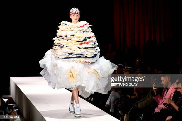 A model presents a creation for Comme des Garcons during the 2018/2019 fall/winter collection fashion show on March 3 2018 in Paris / AFP PHOTO /...