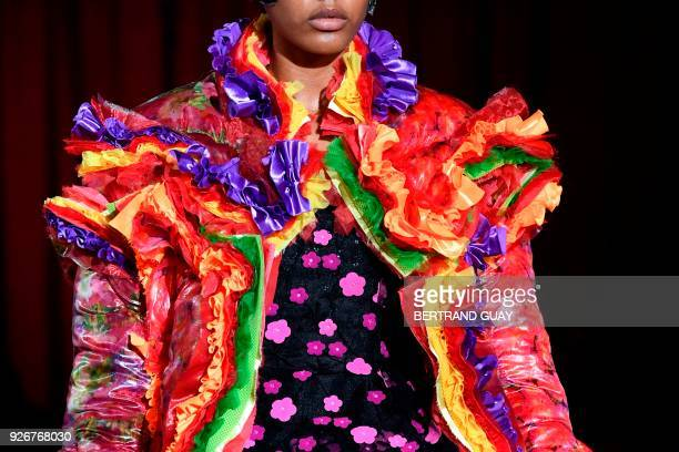 Model presents a creation for Comme des Garcons during the 2018/2019 fall/winter collection fashion show on March 3, 2018 in Paris.