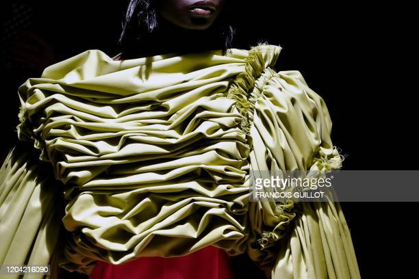 Model presents a creation for Comme des Garcons during the Women's Fall-Winter 2020-2021 Ready-to-Wear collection fashion show in Paris, on February...