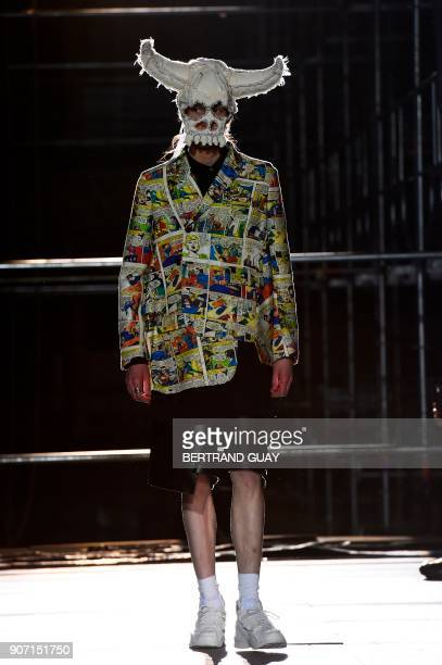 A model presents a creation for Comme Des Garcons Homme plus during men's Fashion Week for the Fall/Winter 2018/2019 collection in Paris on January...