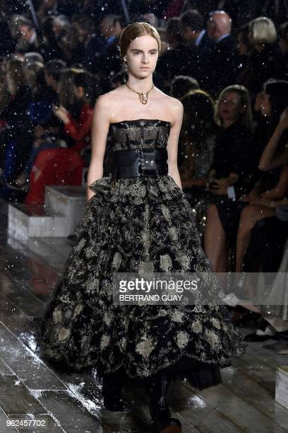 Model presents a creation for Dior during the 2019 Dior Croisiere fashion show on May 25, 2018 at the Grandes écuries de Chantilly, near Paris.