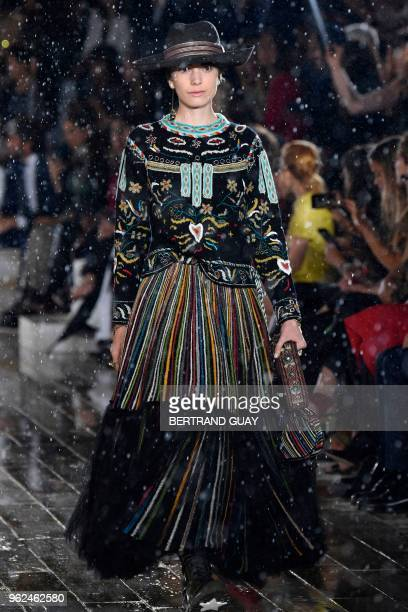 A model presents a creation for Dior during the 2019 Dior Croisiere fashion show on May 25 2018 at the Grandes écuries de Chantilly near Paris