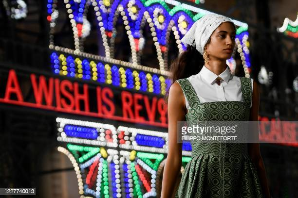 Model presents a creation for Dior during the 2021 Dior Croisiere fashion show on July 22, 2020 in Lecce, southern Italy.
