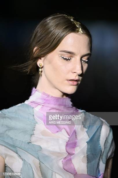 Model presents a creation for Dior during the 2022 Dior Croisiere fashion show, at the Panathenaic Stadium, in Athens, on June 17, 2021.