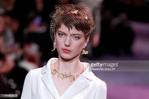 A model presents a creation for Dior during the Women's SpringSummer 2020/2021 Haute Couture collection fashion show in Paris on January 20 2020
