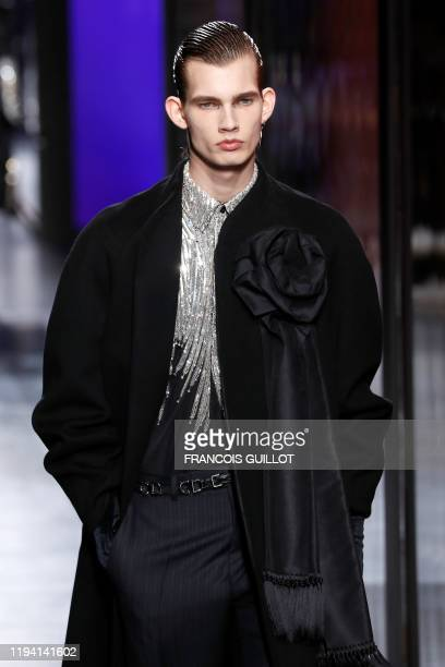A model presents a creation for Dior Homme during the men's Fall/Winter 2020/2021 collection fashion show in Paris on January 17 2020