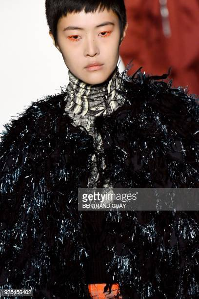 A model presents a creation for Dries Van Noten during the 2018/2019 fall/winter collection fashion show on February 28 2018 in Paris / AFP PHOTO /...