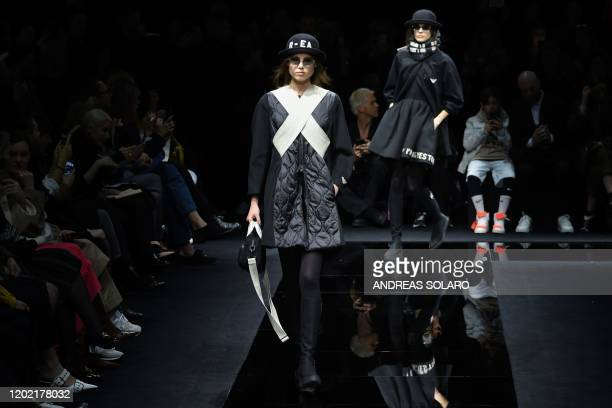 A model presents a creation for Emporio Armani's Women Fall Winter 2020 fashion collection on February 21 2020 in Milan