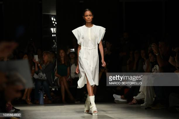A model presents a creation for fashion house Alberto Zambelli during the Women's Spring/Summer 2019 fashion shows in Milan on September 19 2018
