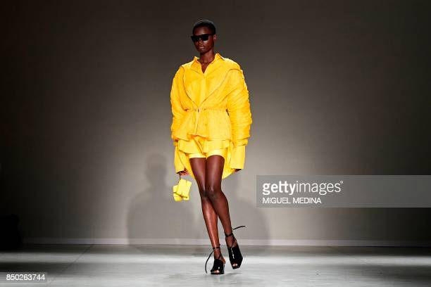 A model presents a creation for fashion house Angel Chen during the Women's Spring/Summer 2018 fashion shows in Milan on September 20 2017