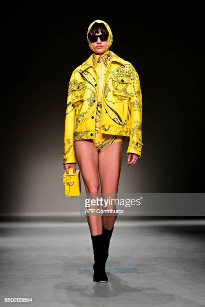 A model presents a creation for fashion house Angel Chen during the Women's Spring/Summer 2018 fashion shows in Milan on September 20 2017 / AFP...