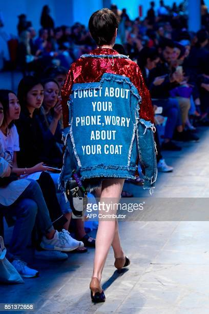 A model presents a creation for fashion house Annakiki during the Women's Spring/Summer 2018 fashion shows in Milan on September 22 2017 / AFP PHOTO...