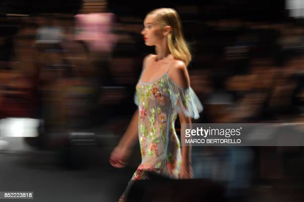 A model presents a creation for fashion house Blumarine during the Women's Spring/Summer 2018 fashion shows in Milan on September 23 2017