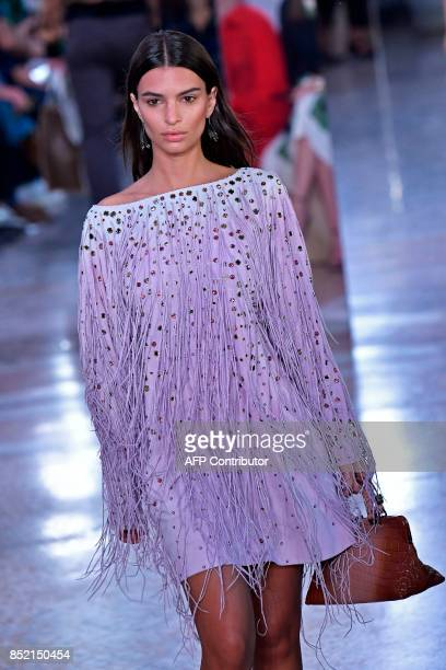 A model presents a creation for fashion house Bottega Veneta during the Women's Spring/Summer 2018 fashion shows in Milan on September 23 2017 / AFP...