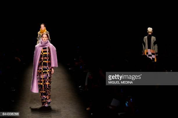 A model presents a creation for fashion house Byblos during the Women's Fall/Winter 2017/2018 fashion week in Milan on February 23 2017 / AFP PHOTO /...