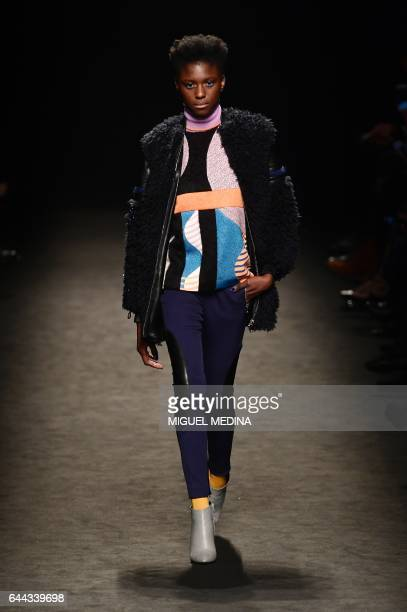 A model presents a creation for fashion house Byblos during the Women's Fall/Winter 2017/2018 fashion week in Milan on February 23 2017 / AFP /...