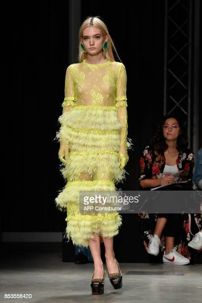 A model presents a creation for fashion house Daizy Shely during the Women's Spring/Summer 2018 fashion shows in Milan on September 25 2017 / AFP...