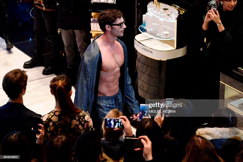 A model presents a creation for fashion house Dolce & Gabbana during a special event at La Rinascente department store as part of Men's Fall/Winter 2019 fashion shows in Milan, on January 14, 2018. / AFP PHOTO / Miguel MEDINA