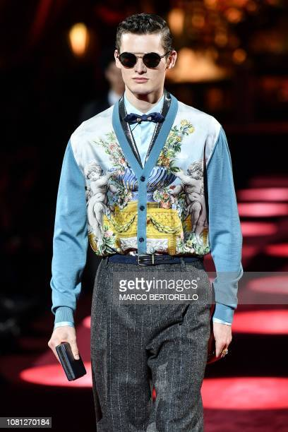 A model presents a creation for fashion house Dolce Gabbana during its Men's Fall/Winter 2019/20 fashion show in Milan on January 12 2019