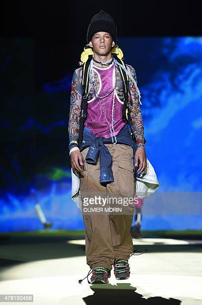 A model presents a creation for fashion house Dsquared2 at the Men SpringSummer 2016 Milan's Fashion Week on June 23 2015 AFP PHOTO / OLIVIER MORIN