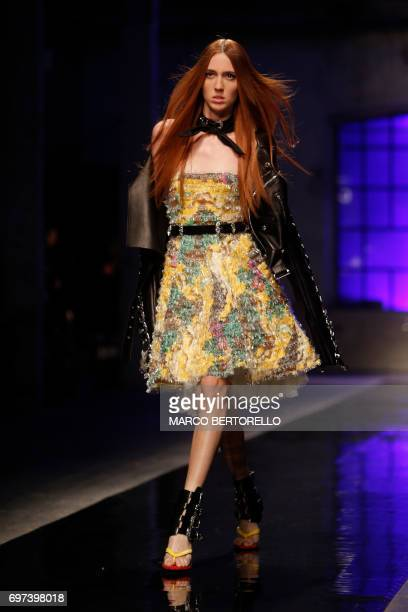 Model presents a creation for fashion house Dsquared2 during the Men's Spring/Summer 2018 fashion shows in Milan, on June 18, 2017. / AFP PHOTO /...
