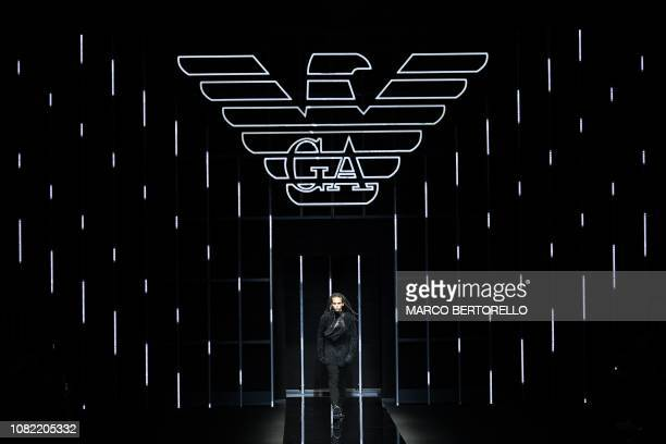 A model presents a creation for fashion house Emporio Armani during its Men's Fall/Winter 2019/20 fashion show in Milan on January 14 2019