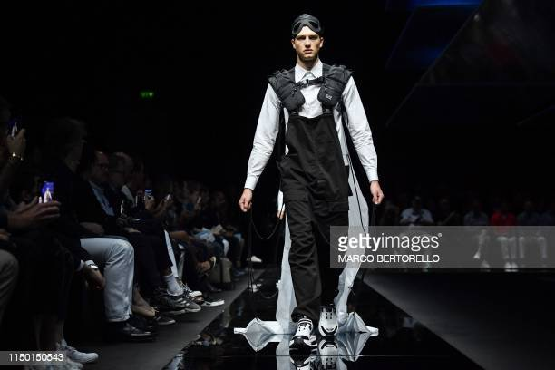 A model presents a creation for fashion house Emporio Armani during the presentation of its men's spring/summer 2020 fashion collection in Milan on...