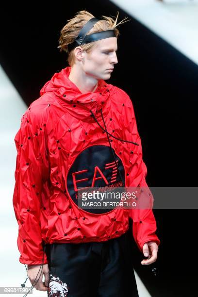 A model presents a creation for fashion house Emporio Armani during the Men's Spring/Summer 2018 fashion shows in Milan on June 17 2017 / AFP PHOTO /...