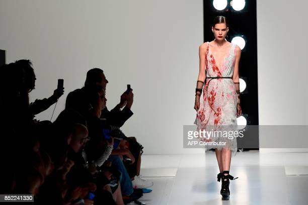 TOPSHOT A model presents a creation for fashion house Ermanno Scervino during the Women's Spring/Summer 2018 fashion shows in Milan on September 23...