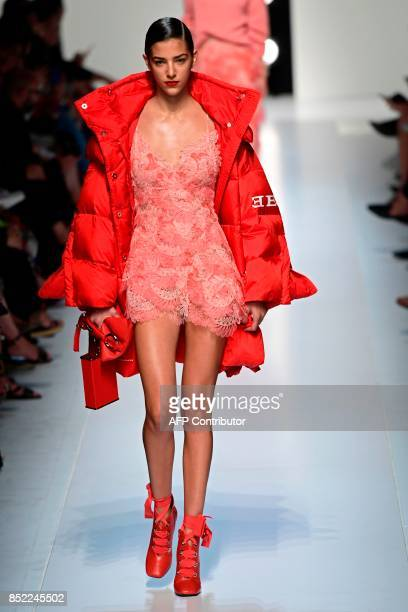 A model presents a creation for fashion house Ermanno Scervino during the Women's Spring/Summer 2018 fashion shows in Milan on September 23 2017 /...