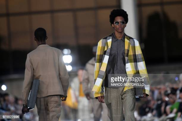 A model presents a creation for fashion house Ermenegildo Zegna during the Men's Spring/Summer 2019 fashion shows in Milan on June 15 2018