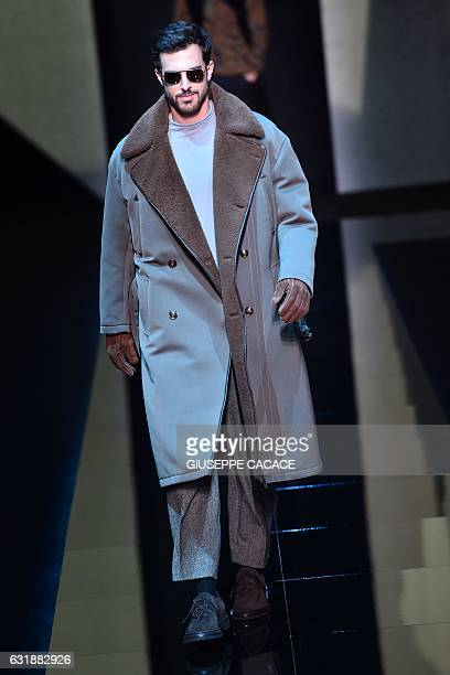 A model presents a creation for fashion house Giorgio Armani during the Men's FallWinter 20172018 fashion week on January 17 2017 in Milan / AFP /...