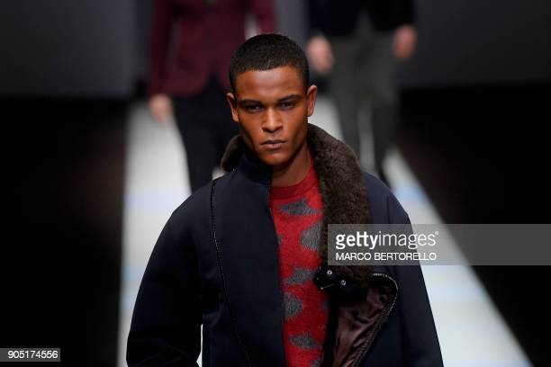 Model presents a creation for fashion house Giorgio Armani during the Men's Fall/Winter 2019 fashion shows in Milan, on January 15, 2018. / AFP PHOTO...