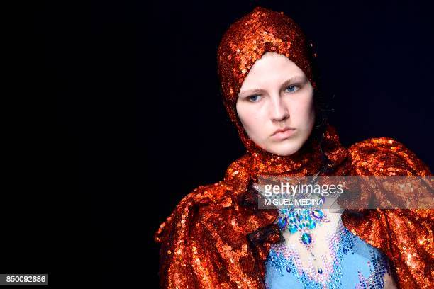 A model presents a creation for fashion house Gucci during the Men and Women's Spring/Summer 2018 fashion shows in Milan on September 20 2017 / AFP...