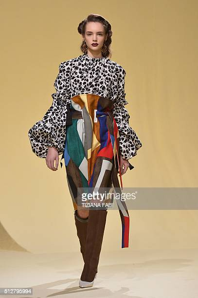 A model presents a creation for fashion house Marni as part of the Women Autumn / Winter 2016 Milan Fashion Week on February 28 2016 AFP PHOTO /...