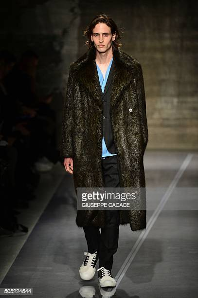 A model presents a creation for fashion house Marni during the Men Fall Winter 2016 / 2017 collection shows at the Milan's Fashion Week on January 16...