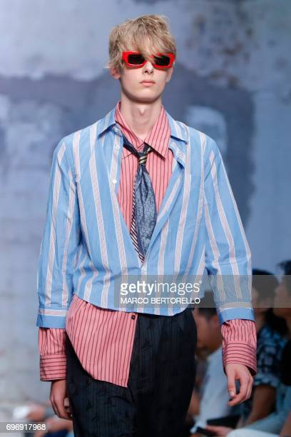 A model presents a creation for fashion house Marni during the Men's Spring/Summer 2018 fashion shows in Milan on June 17 2017 / AFP PHOTO / Marco...
