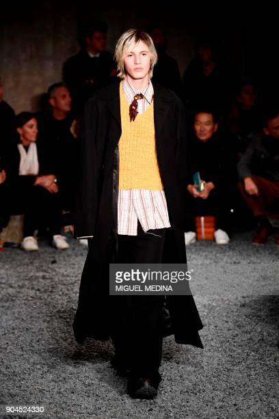 A model presents a creation for fashion house Marni during the Men's Fall/Winter 2019 fashion shows in Milan on January 13 2018 / AFP PHOTO / Miguel...