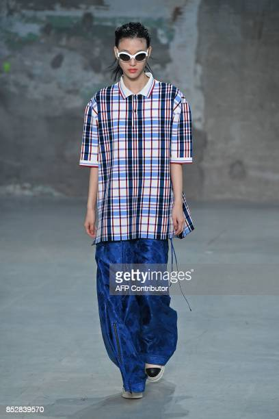 A model presents a creation for fashion house Marni during the Women's Spring/Summer 2018 fashion shows in Milan on September 24 2017 / AFP PHOTO /...