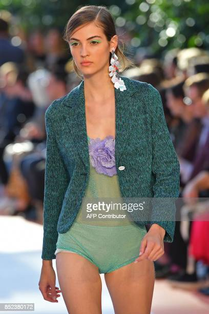 Model presents a creation for fashion house Missoni during the Men and Women's Spring/Summer 2018 fashion shows in Milan, on September 23, 2017. /...