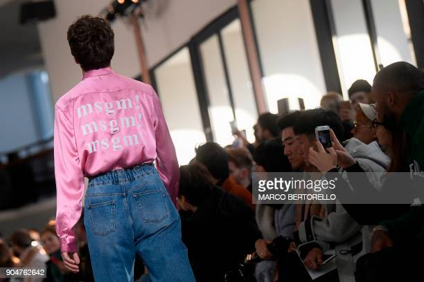 A model presents a creation for fashion house MSGM during the Men's Fall/Winter 2019 fashion show in Milan on January 14 2018 / AFP PHOTO / Marco...