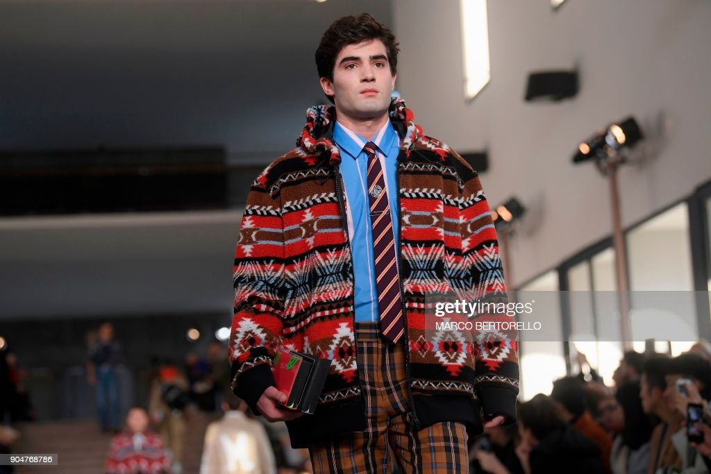A model presents a creation for fashion house MSGM during the Men's Fall/Winter 2019 fashion show in Milan, on January 14, 2018. / AFP PHOTO / Marco BERTORELLO