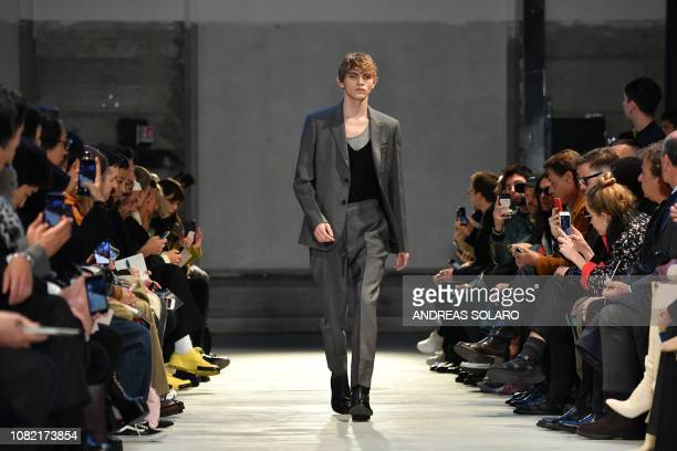 A model presents a creation for fashion house N21 during its Men's Fall/Winter 2019/20 fashion show in Milan on January 14 2019