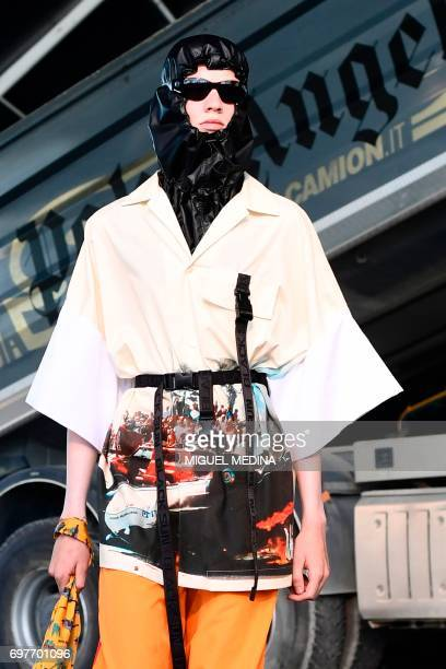 Model presents a creation for fashion house Palm Angels during the Men's Spring/Summer 2018 fashion shows in Milan, on June 19, 2017. / AFP PHOTO /...