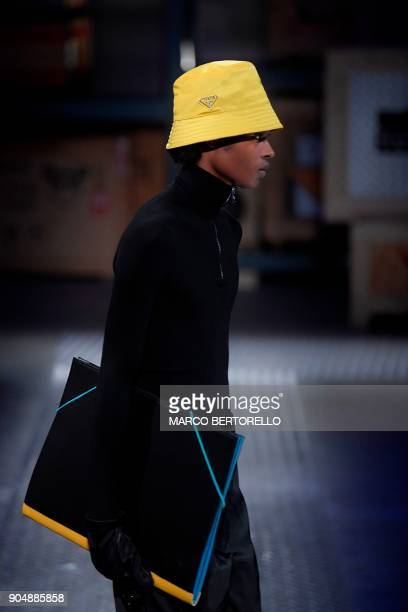 A model presents a creation for fashion house Prada during the Men's Fall/Winter 2019 fashion shows in Milan on January 14 2018 / AFP PHOTO / Marco...
