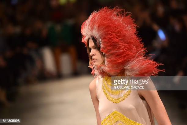 A model presents a creation for fashion house Prada during the Women's Fall/Winter 2017/2018 fashion week in Milan on February 23 2017 / AFP /...