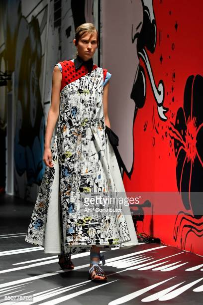 A model presents a creation for fashion house Prada during the Women's Spring/Summer 2018 fashion shows in Milan on September 21 2017 / AFP PHOTO /...