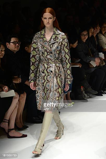 A model presents a creation for fashion house Salvatore Ferragamo as part of the spring/summer 2014 readytowear collections during the fashion week...