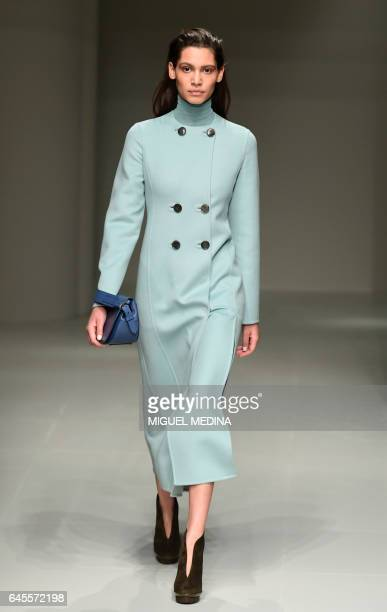 Model presents a creation for fashion house Salvatore Ferragamo during the Women's Fall/Winter 2017/2018 fashion week in Milan, on February 26, 2017....